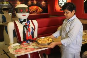 Robot Servers Dish Out Pizza to Happy Customers in Pakistan