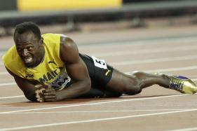 Usain Bolt Limps Out of Career's Last Race to Gasps of 60,000-strong Crowd