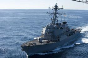China Protests After US Warship Sails Near Island in South China Sea