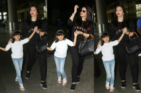 Aaradhaya Turns Airport Into Runway, Steals The Limelight From Aishwarya