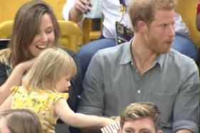 Watch This Fearless Little Goofball Steal Popcorn From Prince Harry