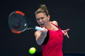 Top-ranked Simona Halep Crushes Caroline Garcia at WTA Finals
