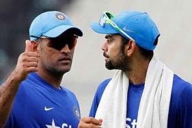 Dhoni Chills With His Dog as Kohli Warms Up for T20I Series