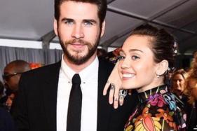 Miley Cyrus, Liam Hemsworth Make a Rare Red Carpet Appearance