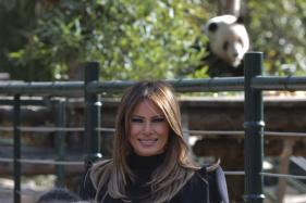 Melania Trump Meets China's Furry Diplomats, Hikes Great Wall