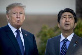 In Japan, Trump Pushes New Trade Deal, Mourns Texas Shooting