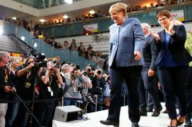 Merkel Hangs on to Power in Germany But Bleeds Support to Far Right