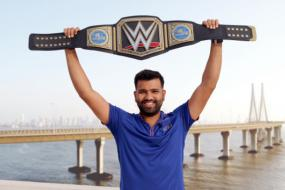 Rohit Sharma Strikes a Pose with Special Gift from Triple H