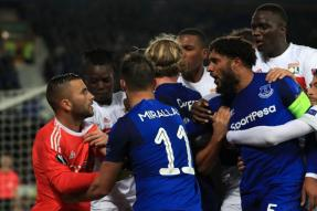 Everton Fan Holding Child 'Punches' Lyon Player During Europa League Game