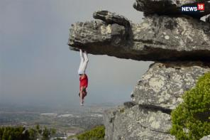 Daredevil Hangs Upside Down On a Cliff