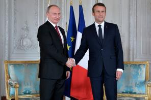 French President Emmanuel Macron meets Russian President Vladimir Putin in France