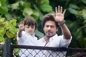 Shah Rukh Khan, accompanied by son AbRam, greets fans on Eid