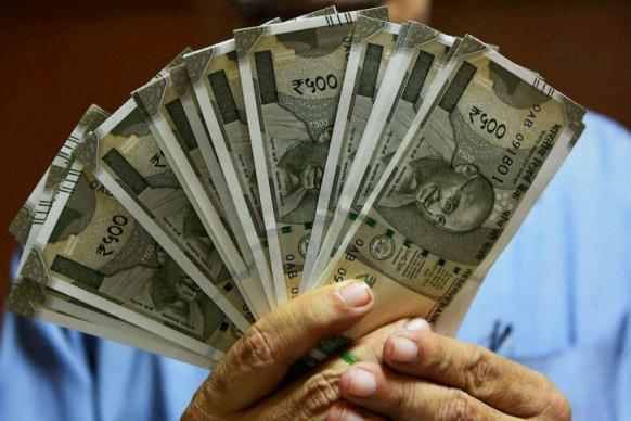 Rupee Drops 4 Paise Against US Dollar