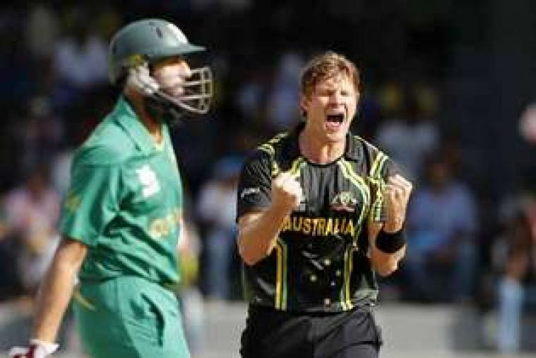 Xavier Doherty (left) celebrates after taking the wicket of Jacques Kallis. (AP Photo)