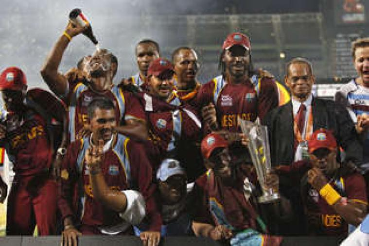 West Indies players pose with the World T20 trophy following their 36-run win against Sri Lanka at Colombo's Premadasa on Sunday night. (AP Photo)