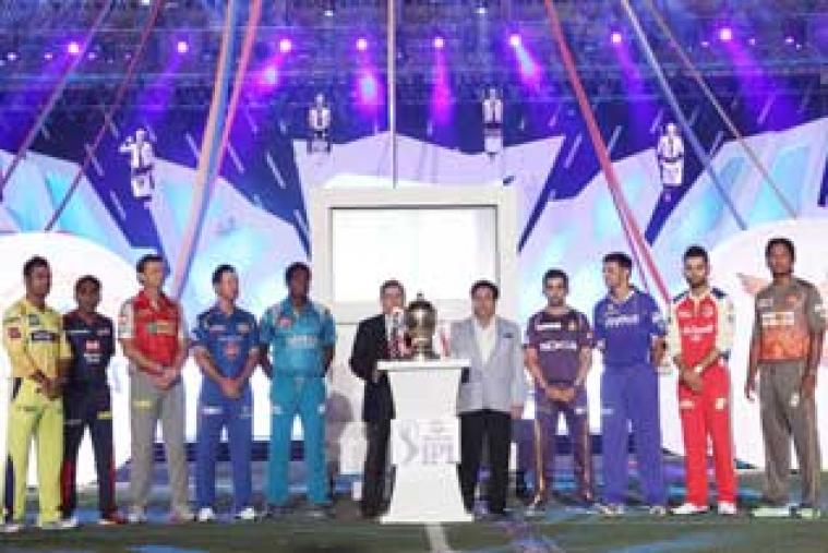 IPL captains from the nine franchises stand on the stage, with the trophy that they will be playing for shining in the middle.