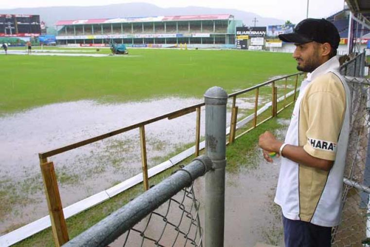 The first two matches of the series were washed out without a ball being bowled. Here, Harbhajan Singh looks at the flooded Sabina Park in Kingston before the second ODI was abandoned. (AFP)