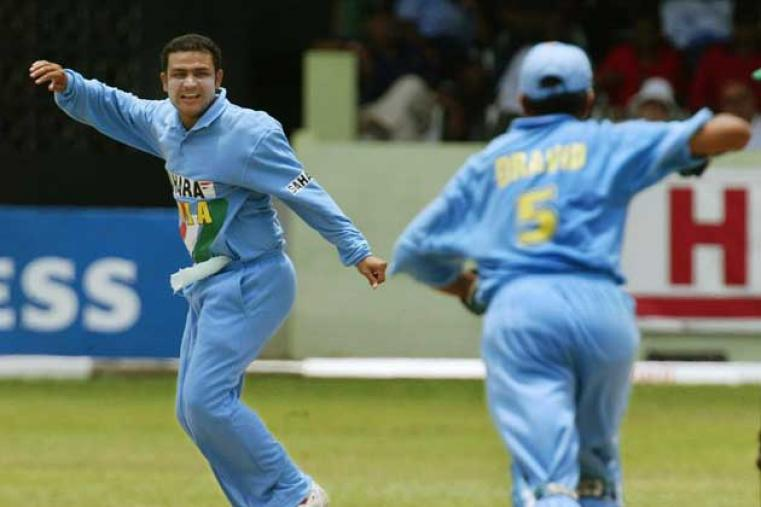 Virender Sehwag, still finding his way in international cricket, picked up two wickets with the ball. (AFP)