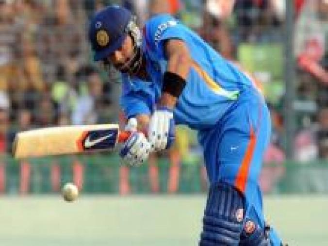 Kohli marked his World Cup debut with 100* off 83 balls as India got the 2011 edition off to a winning start with an 87-run win over Bangladesh in Dhaka. (AFP)