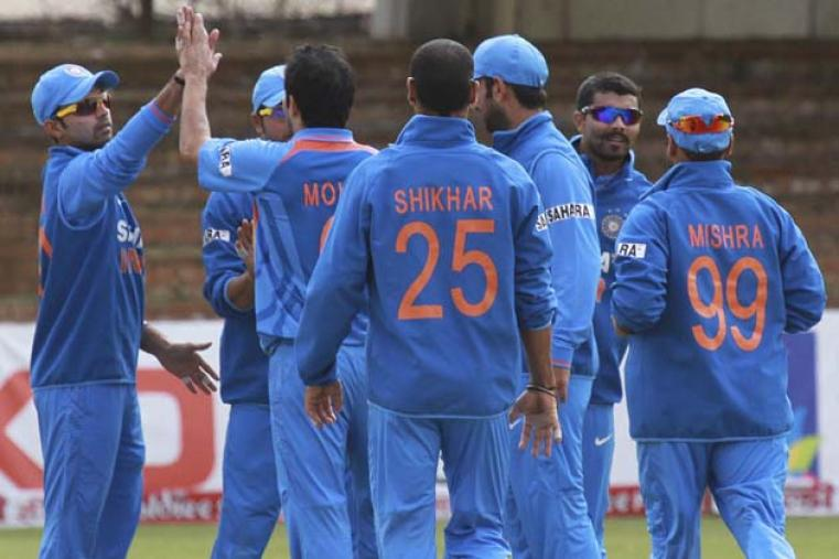 The Indian players celebrate the wicket of Hamilton Masakadza. (AP Photo)