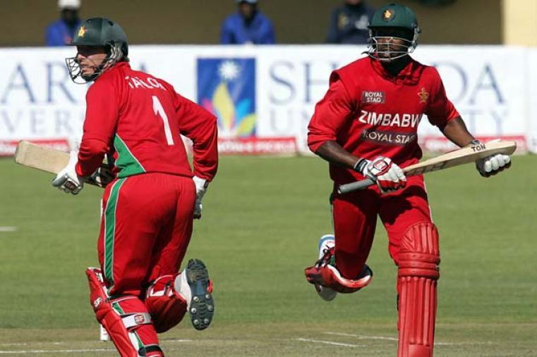 Vusi Sibanda and Brendan Taylor take a run after Zimbabwe were put in to bat. (AFP)