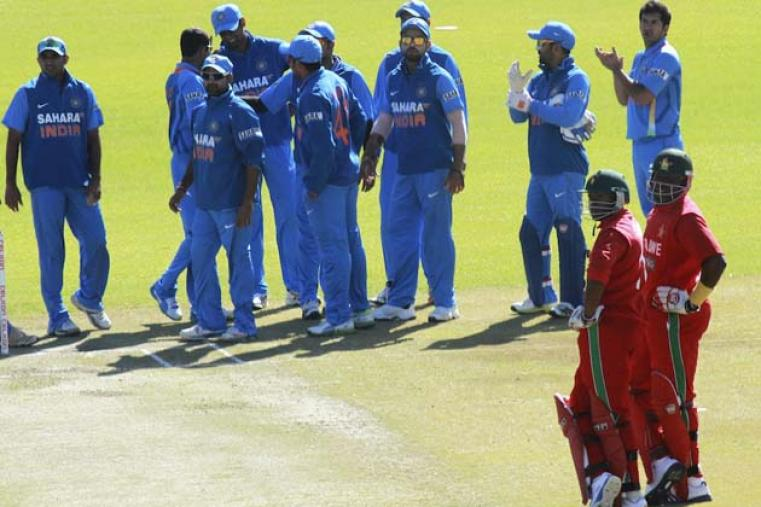Indian players wait for a run out decision involving Hamilton Masakadza. (AP Photo)