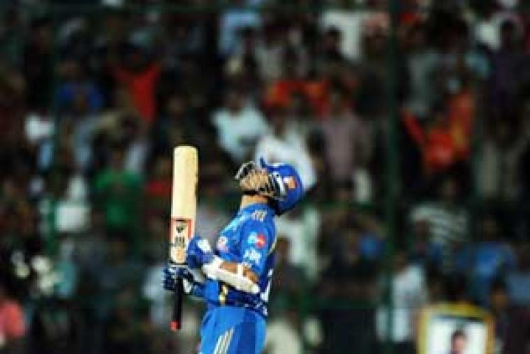 Sachin Tendulkar has been part of Mumbai Indians ever since IPL came to life in 2008. Here the master blaster is clicked on April 15, 2011, after smashing his first and only T20 hundred during an IPL match against the now-defunct Kochi Tuskers Kerala. (AFP)