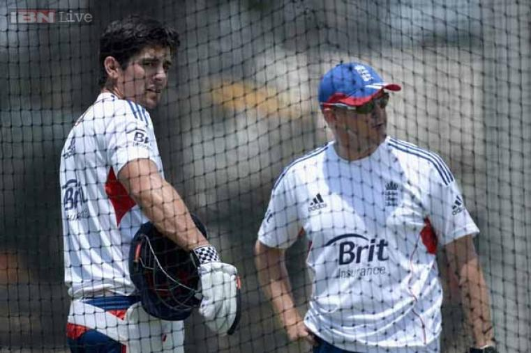 England captain Alastair Cook speaks with coach Andy Flower during an England nets session at The Gabba in Brisbane.