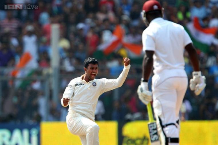 Pragyan Ojha's second five-for of the match (5 for 49) dismissed the Windies for 187. He was declared Man of the Match for his match-haul of 10 for 89.