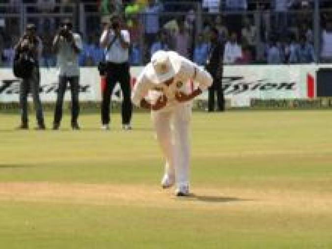 The on-field festivities came to a fitting end with Sachin going back to the middle of the ground to touch the pitch, and with it a million hearts. (BCCI)