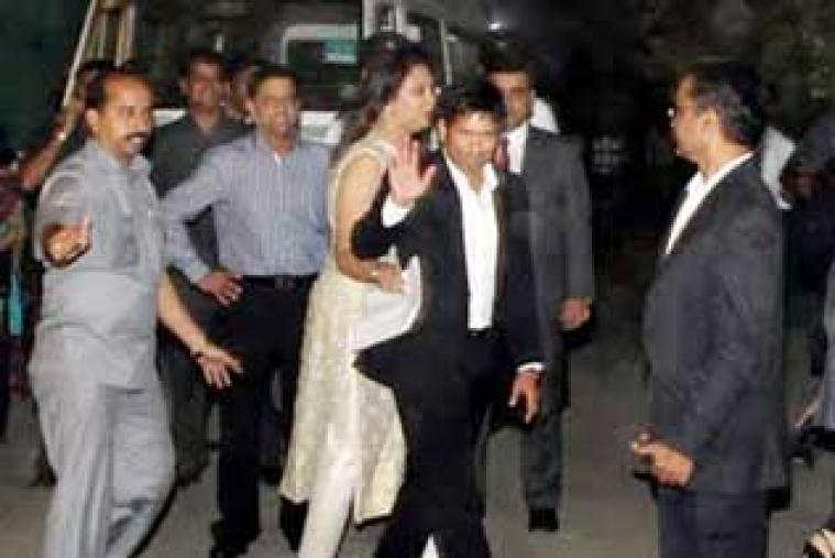 Sachin Tendulkar along with his wife Anjali Tendulkar arrives at the hotel to host a dinner party on Monday night.