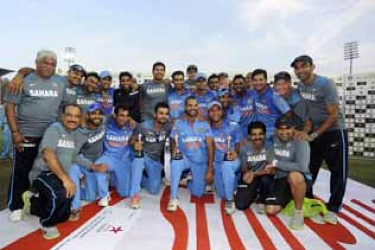 The members of the Indian team pose with the trophy after winning the third and deciding ODI against West Indies. (BCCI)
