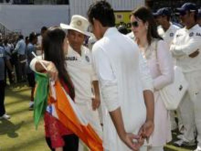 Sachin talking to daughter Sara with son Arjun and wife Anjali looking on. (BCCI)