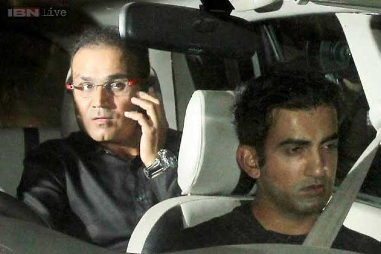 India's discarded openers Gautam Gambhir and Virender Sehwag arrive together.