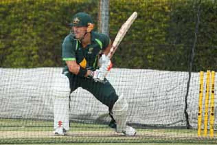 David Warner bats during an Australian nets session at Allan Border Field in Brisbane.