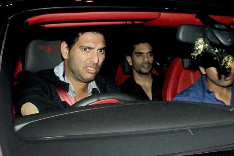 Yuvraj Singh drives into the hotel.