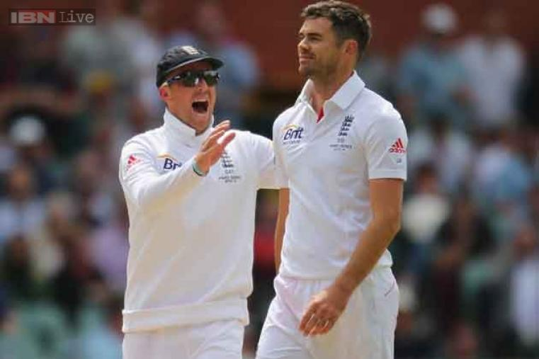 James Anderson celebrates with Graeme Swann after dismissing Shane Watson for 51.