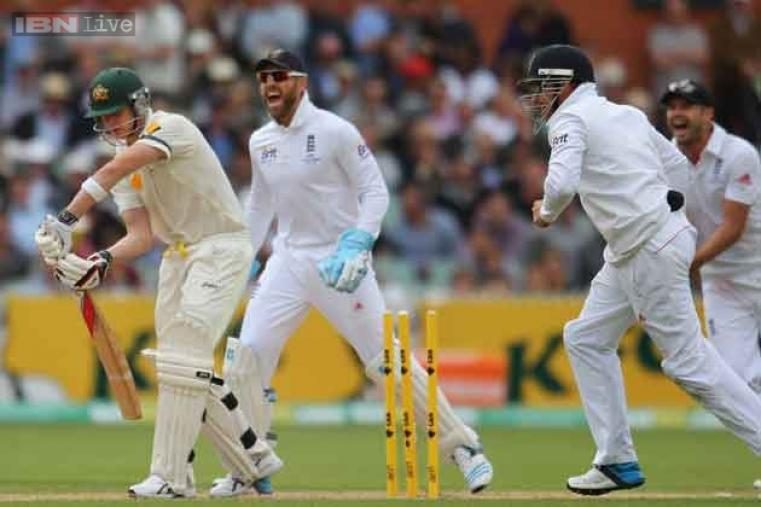 England celebrate after Steve Smith is bowled by England spinner Monty Panesar.