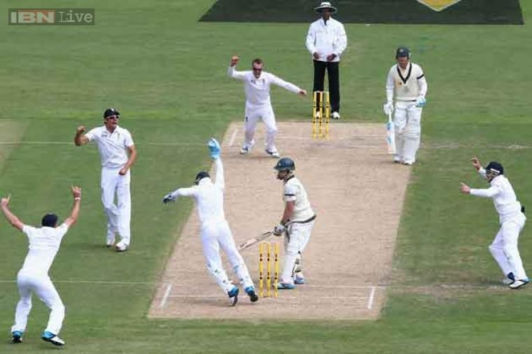 Graeme Swann and Matt Prior celebrate after taking the wicket of Chris Rogers.