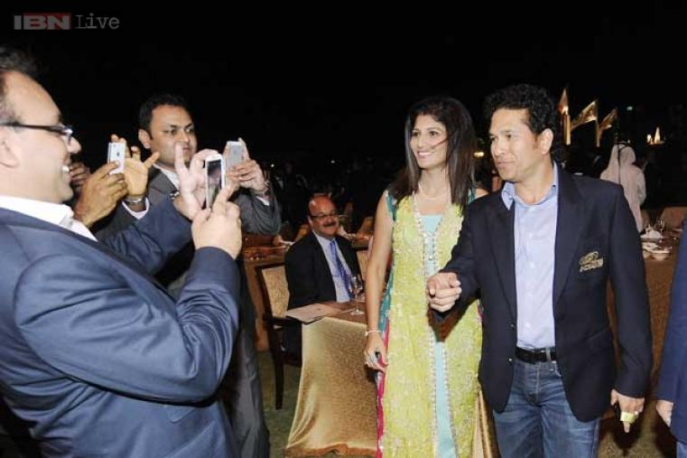 Indian batting legend and Mumbai Indians 'Icon' Sachin Tendulkar arrives at the event.