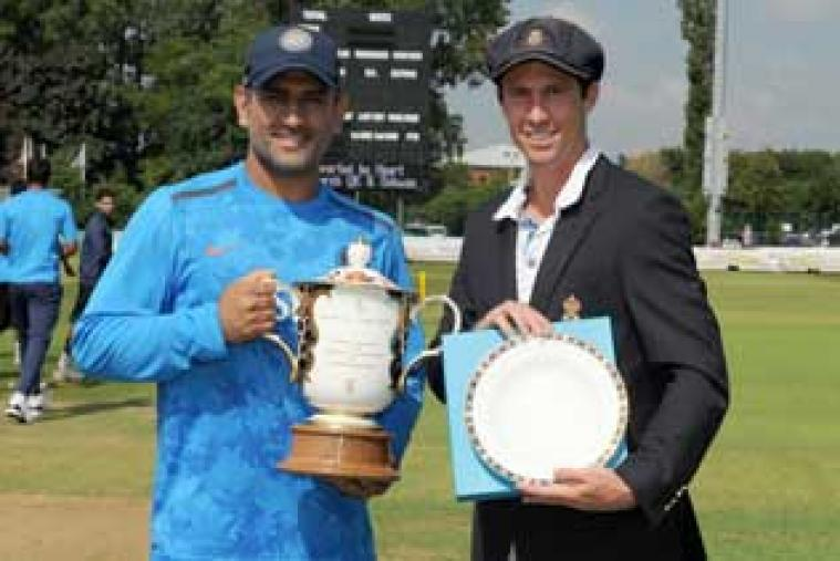 Wayne Madsen, captain of Derbyshire and MS Dhoni, captain of India, with the Royal Crown Derby Trophy and Plate before the match.