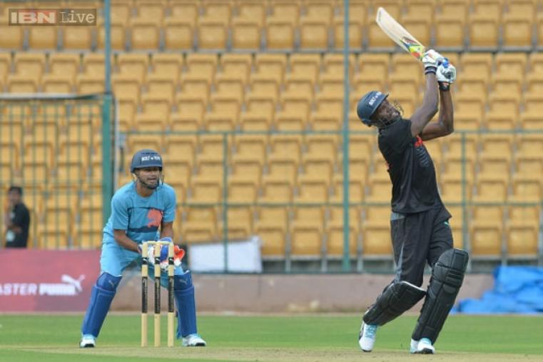 Usain Bolt hits a six during the four-over exhibition cricket match at Chinnaswamy Stadium.