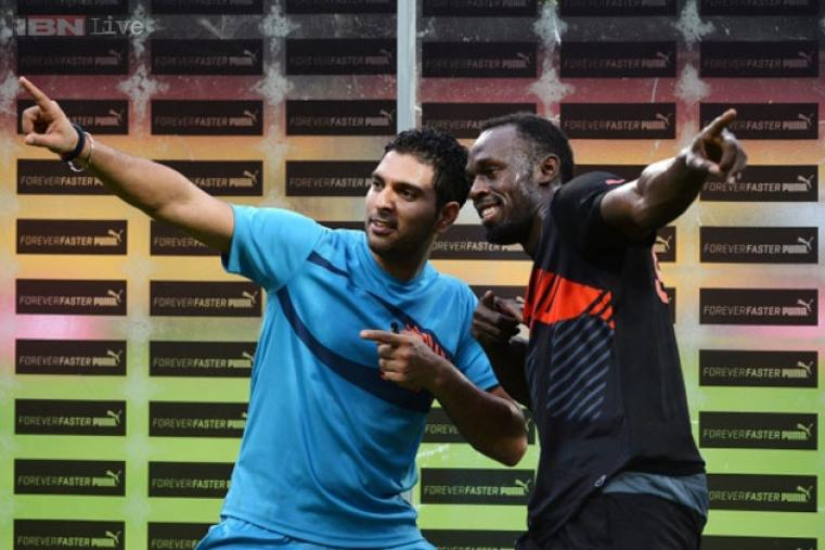 Bolt and Yuvraj pose for a photograph after the match.