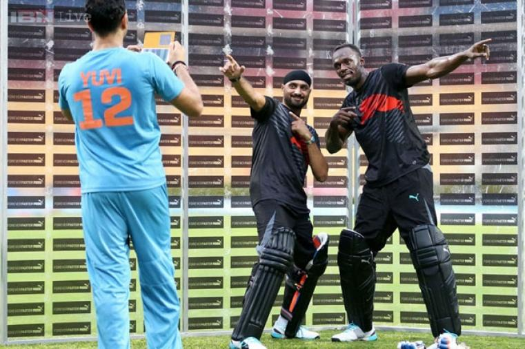 Yuvraj Singh clicks a picture of Harbhajan Singh and Usain Bolt after the match.