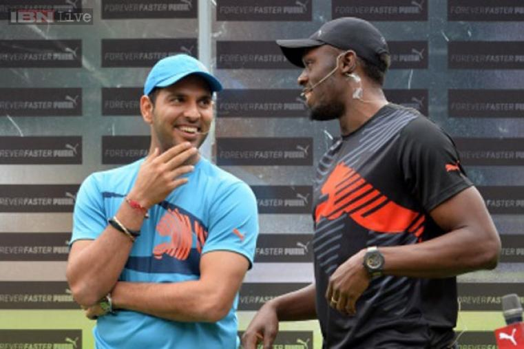 Usain Bolt and Yuvraj Singh share a light moment prior to the match.