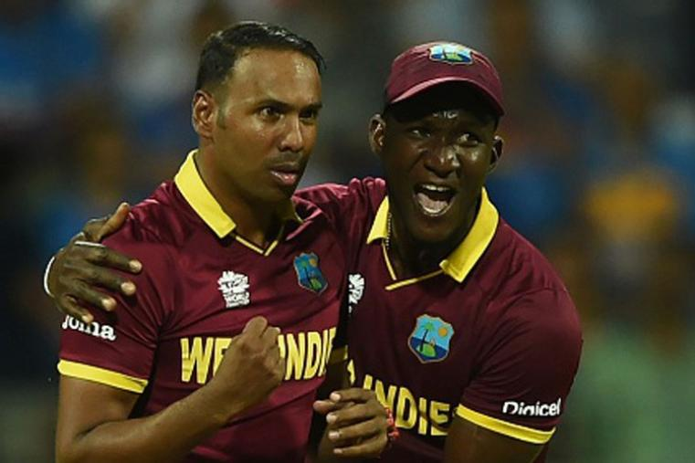 Samuel Badree celebrating with West Indies skipper after picking up the wicket of Rohit. (Getty Images)
