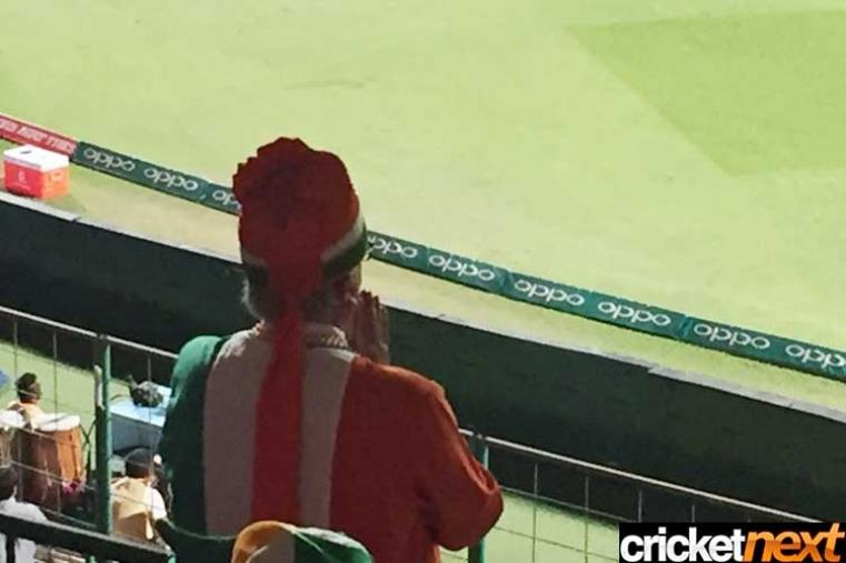 An India fan prays for his team's victory during the India vs Bangladesh match at Chinnaswamy Stadium. (Getty Images)