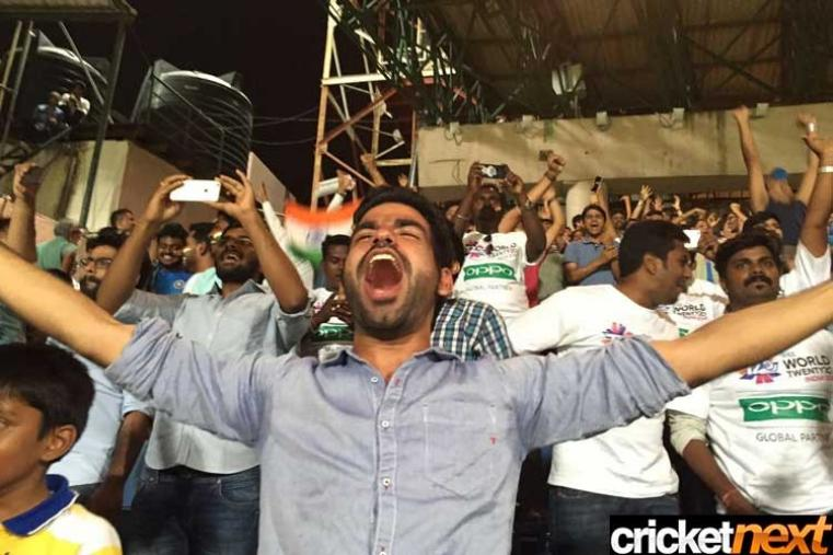 Fans celebrate after India beat Bangladesh by one run in the group stage Super 10 World Twenty20 match at Chinnaswamy Stadium in a humdinger of a contest. (Getty Images)