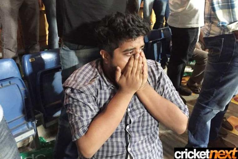 A fan shows his dejection after Bangladesh lost the thrilling clash against India. (Getty Images)