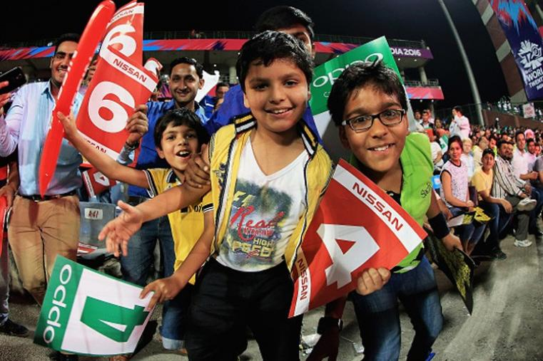 Cricket supporters look excited during the ICC World Twenty20's first semi-final at the Feroz Shah Kotla Stadium. (Getty Images)